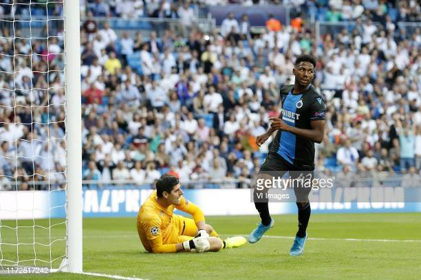 Real Madrid goalkeeper Thibaut Courtois, Emmanuel Dennis of Club Brugge KV during the UEFA Champions League group A match between Real Madrid and...