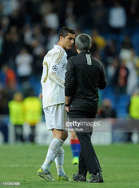 Real Madrid head coach Jose Mourinho talks to Cristiano Ronaldo during the UEFA Champions League Round of 16 second leg match between Real Madrid and...