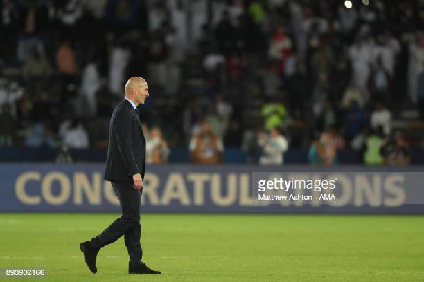 Real Madrid Head Coach / Manager Zinedine Zidane looks on at the end of the FIFA Club World Cup UAE 2017 final match between Gremio and Real Madrid...