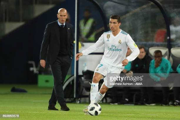 Real Madrid Head Coach / Manager Zinedine Zidane watches Cristiano Ronaldo of Real Madrid during the FIFA Club World Cup UAE 2017 final match between...