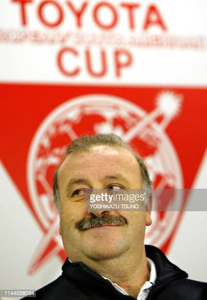 Real Madrid head coach Vicente Del Bosque smiles before a logo of the Toyota Cup during a press conference after the team's training session at the...