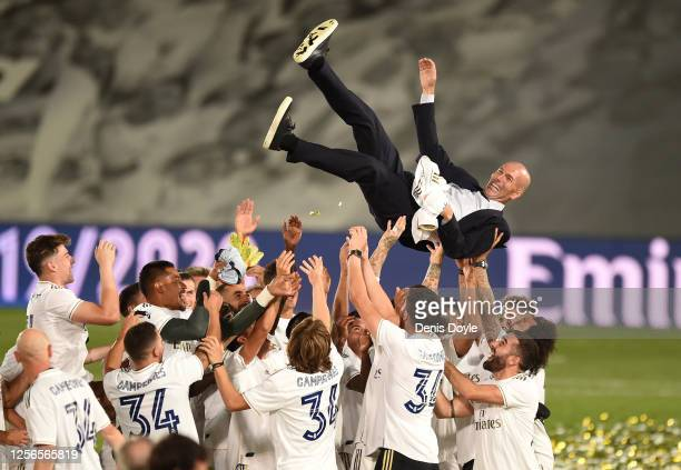 Real Madrid head coach Zinedine Zidane is thrown up in the air by his players after Madrid secure the La Liga title during the Liga match between...