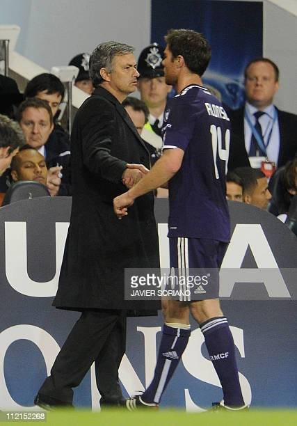 Real Madrid Head Jose Mourinho greets Real Madrid's Xabi Alonso during play against Tottenham Hotspur during a UEFA Champions League Quarter Final...
