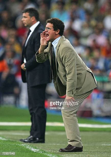 Real Madrid manager Fabio Capello instructs his team beside Steaua Bucharest manager Cosmin Olaroiu during the UEFA Champions League Group E match...