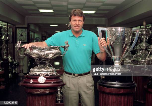 Real Madrid manager John Toshack with the La Liga championship trophy in the trophy museum at the Bernabeu Stadium in Madrid Spain circa June 1990