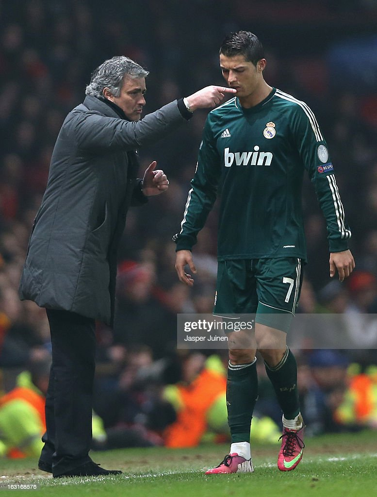 Real Madrid Manager Jose Mourinho gives orders to Cristiano Ronaldo during the UEFA Champions League Round of 16 Second leg match between Manchester United and Real Madrid at Old Trafford on March 5, 2013 in Manchester, United Kingdom.