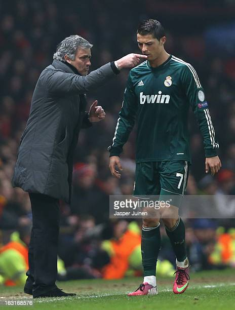 Real Madrid Manager Jose Mourinho gives orders to Cristiano Ronaldo during the UEFA Champions League Round of 16 Second leg match between Manchester...