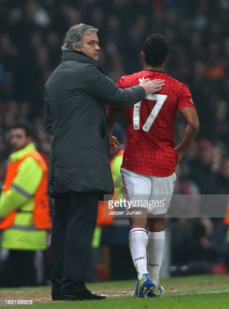 Real Madrid Manager Jose Mourinho pats Nani of Manchester United on the back after he is sent off during the UEFA Champions League Round of 16 Second...