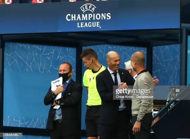Real Madrid Manager Zinedine Zidane and Manchester City Manager Pep Guardiola meet ahead of the UEFA Champions League round of 16 second leg match...