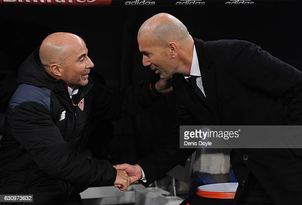 Real Madrid manager Zinedine Zidane greets Sevilla FC manager Jorge Sampaoli during the Copa del Rey Round of 16 First Leg match between Real Madrid...