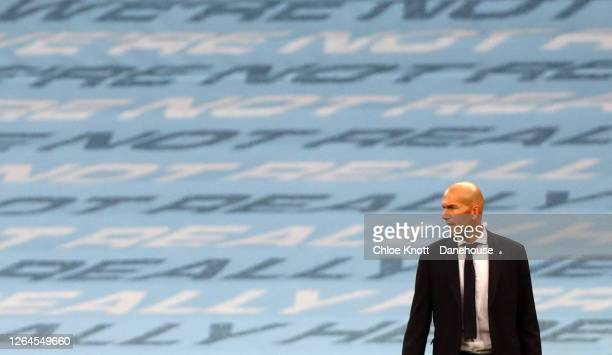 Real Madrid Manager Zinedine Zidane looks on during the UEFA Champions League round of 16 second leg match between Manchester City and Real Madrid at...