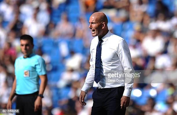Real Madrid manager Zinedine Zidane reacts during the La Liga match between Real Madrid CF and CA Osasuna at Estadio Santiago Bernabeu on September...