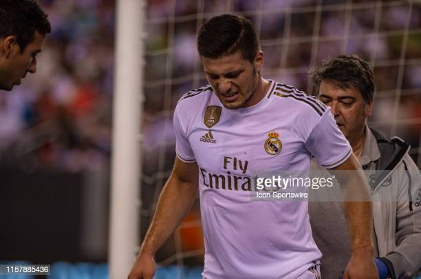 Real Madrid midfielder Luka Jovic winces in pain after suffering an injury during the International Champions Cup friendlies match between Real...