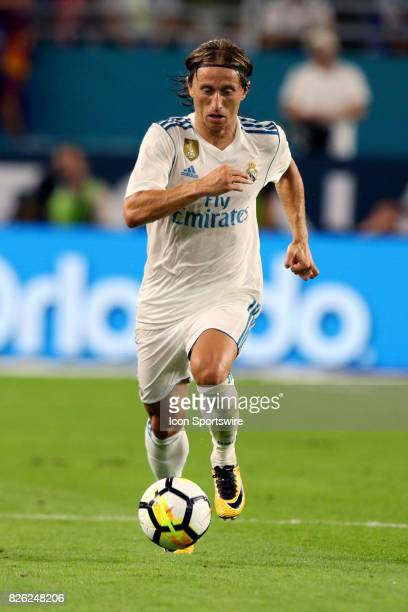 Real Madrid midfielder Luka Modric in action during the first half of the International Champions Cup match against Barcelona at Hard Rock Stadium in...