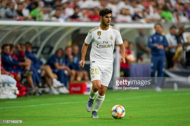 Real Madrid midfielder Marco Asensio dribbles the ball during the International Champions Cup soccer match between FC Bayern and Real Madrid on July...
