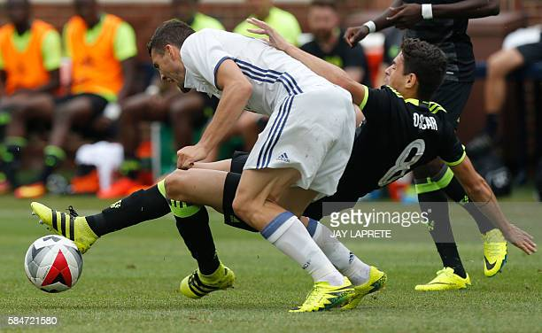 Real Madrid midfielder Mateo Kovacic and Chelsea midfielder Oscar collide during an International Champions Cup soccer match in Ann Arbor Michigan on...