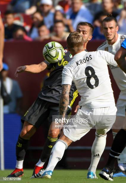 Real Madrid midfielder Toni Kroos and Juventus midfielder Miralem Pjanic battle for a ball during an International Champions Cup match between Real...