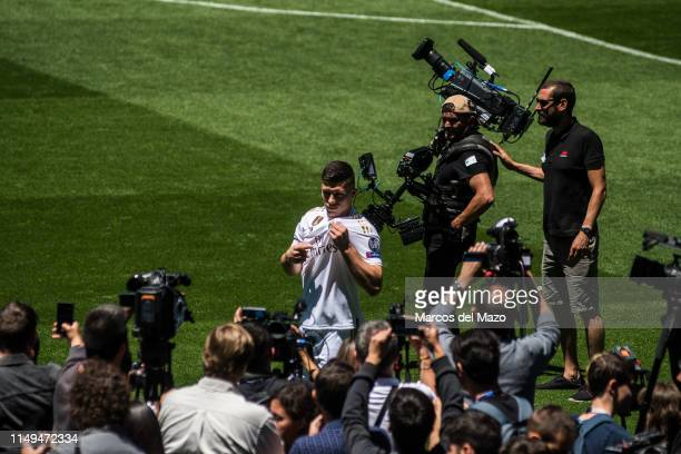 Real Madrid new player Luka Jovic gets pictured and filmed during his presentation in Santiago Berbabeu Stadium.