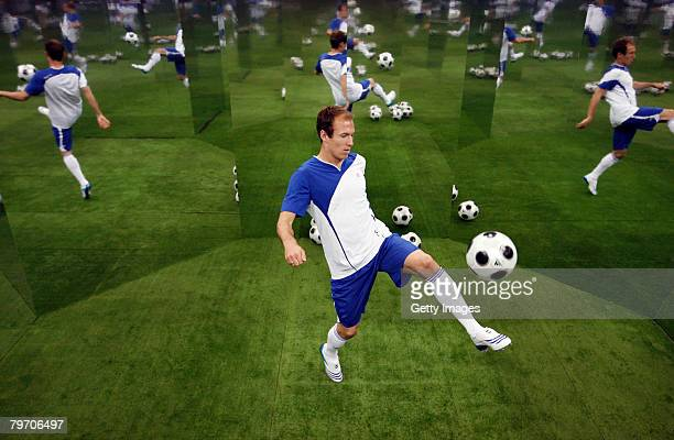 Real Madrid player Arjen Robben juggles the ball while posing for a portait during the adidas F50 TUNiT football boot launch on February 11 2008 in...