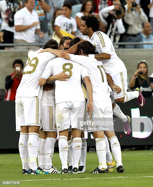 Real Madrid player Callejon gets congratulated by teammates after his goal during the Herbalife World Football Challenge Friendly match between LA...