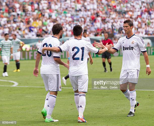 Real Madrid player Cristiano Ronaldo congratulates teammate Jose Maria Callejon after his goal during the Herbalife World Football Challenge match...