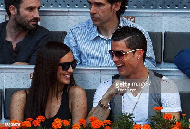 Real Madrid player Cristiano Ronaldo cuddles with his girlfriend Irina Shayk during the match between Rafael Nadal and David Ferrer of Spain on day...