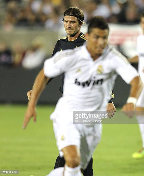 Real Madrid player Cristiano Ronaldo runs past LA Galaxy's David Beckham toward the goal during the Herbalife World Football Challenge Friendly match...