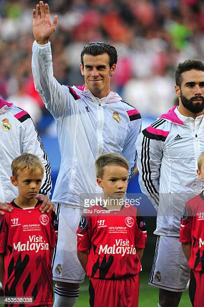 Real Madrid player Gareth Bale waves before the UEFA Super Cup match between Real Madrid and Sevilla FC at Cardiff City Stadium on August 12 2014 in...