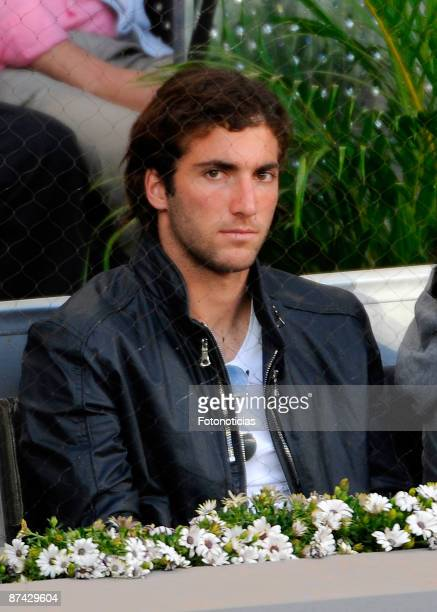 Real Madrid player Gonzalo Higuain attends Madrid Open tennis tournament at La Caja Magica on May 15 2009 in Madrid Spain