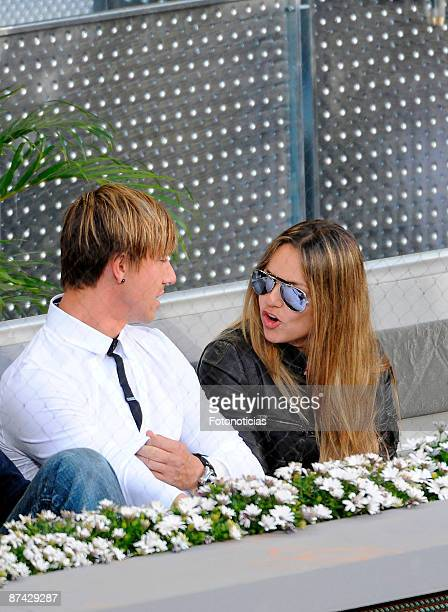 Real Madrid player Jose Maria Gutierrez Guti and friend attend Madrid Open tennis tournament at La Caja Magica on May 15 2009 in Madrid Spain
