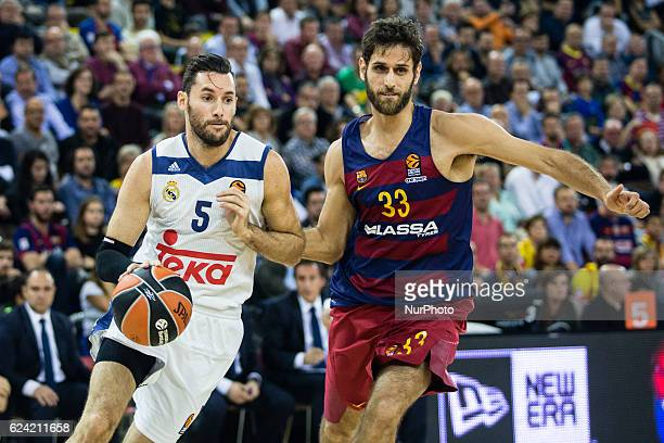Real Madrid player Rudy Fernandez from Spain defensed by The FC Barcelona player Stratos Perperoglou from Greece in action during the Euroleague...