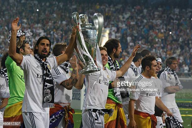 Real Madrid player Sami Khedira lifts the trophy during the Real Madrid celebration the day after winning the UEFA Champions League final at Santiago...
