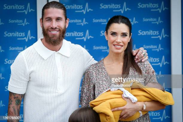 Real Madrid player Sergio Ramos and his wife Pilar Rubio present their new born child Maximo Adriano at La Moraleja Hospital on July 28, 2020 in...