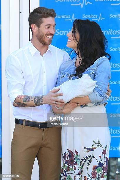 Real Madrid player Sergio Ramos and Pilar Rubio present their new born son Sergio outside Hospital La Moraleja on May 9 2014 in Madrid Spain