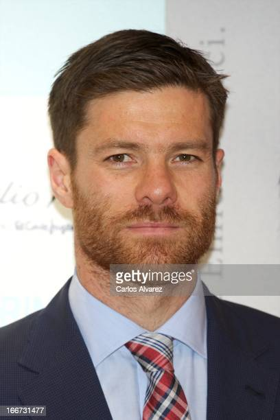 Real Madrid player Xabi Alonso presents the new 'Emidio Tucci Black' collection at the El Corte Ingles Serrano store on April 16 2013 in Madrid Spain