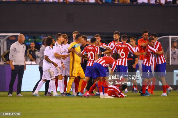 Real Madrid players and Atletico Madrid players push and shove during the second half of the International Champions Cup game between Real Madrid and...