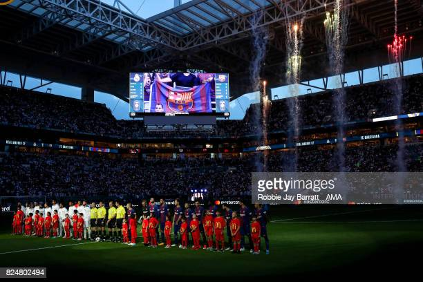 Real Madrid players and FC Barcelona players line up in front of a fire work display prior to the International Champions Cup 2017 match between Real...