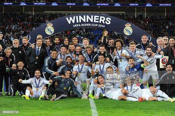 Real Madrid players and officials celebrate winning the UEFA Super Cup Final between Real Madrid CF and Sevilla FC at the Cardiff City Stadium in...