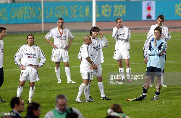 """Real Madrid players are dejected the after Zaragoza won the """"Copa del Rey"""" final between Real Madrid and Zaragoza at Montjuic Stadium March 17, 2004..."""