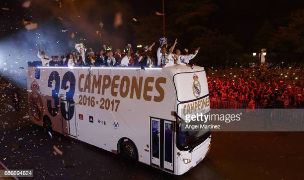 Real Madrid players arrive at Cibeles square after winning the La liga title on May 21 2017 in Madrid Spain Real earlier beat Malaga 20 in Malaga to...