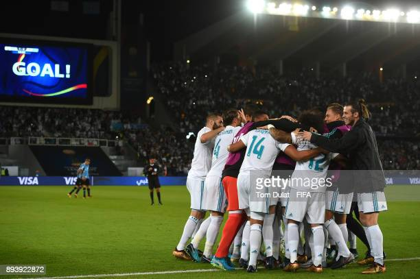 Real Madrid players celebrate a goal by Cristiano Ronaldo during the FIFA Club World Cup UAE 2017 final match between Gremio and Real Madrid at Zayed...