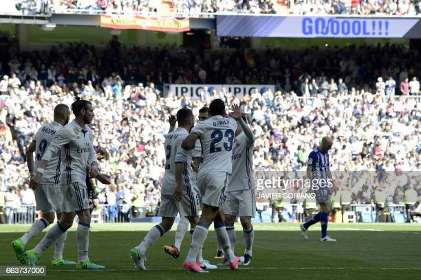 Real Madrid players celebrate a goal during the Spanish league football match Real Madrid CF vs Deportivo Alaves at the Santiago Bernabeu stadium in...