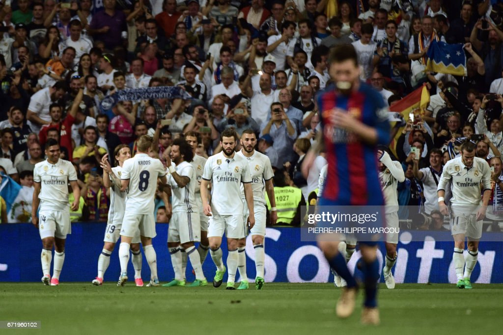 Real Madrid players celebrate a goal during the Spanish league football match Real Madrid CF vs FC Barcelona at the Santiago Bernabeu stadium in Madrid on April 23, 2017. /