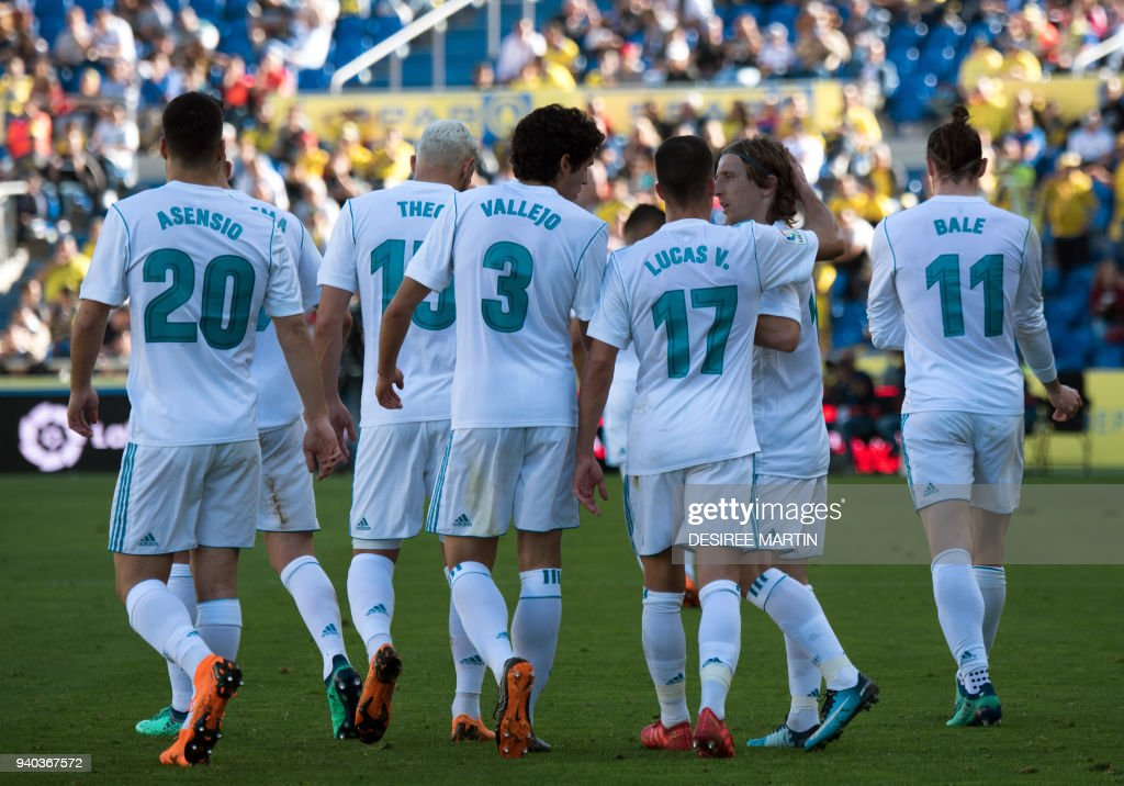 Real Madrid players celebrate a goal during the Spanish League football match between UD Las Palmas and Real Madrid CF at the Gran Canaria stadium in Las Palmas on March 31, 2018. /