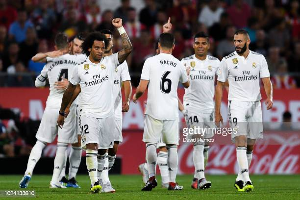 Real Madrid players celebrate after Gareth Bale of Real Madrid CF scored his team's third goal during the La Liga match between Girona FC and Real...