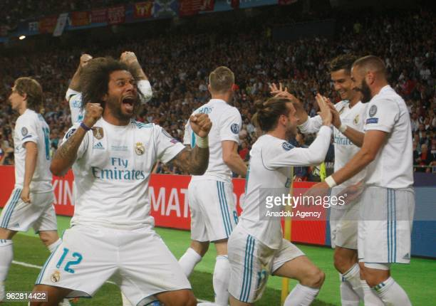 Real Madrid players celebrate after scoring a goal during the UEFA Champions League final football match between Real Madrid and Liverpool FC at the...