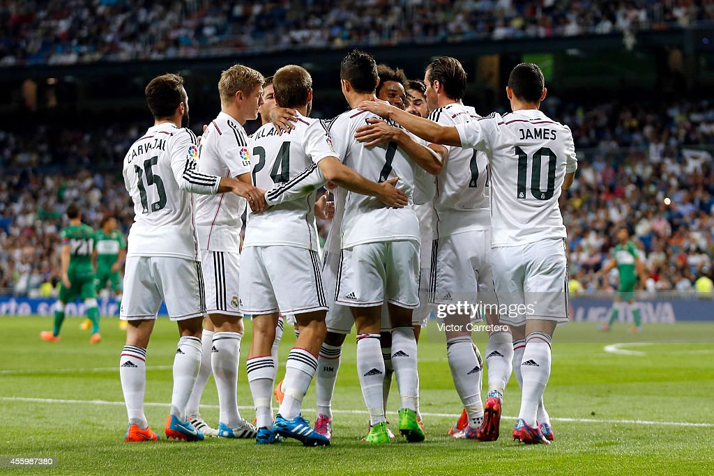 Real Madrid players celebrate after scoring during the La Liga match between Real Madrid CF and Elche FC at Estadio Santiago Bernabeu on September 23, 2014 in Madrid, Spain.