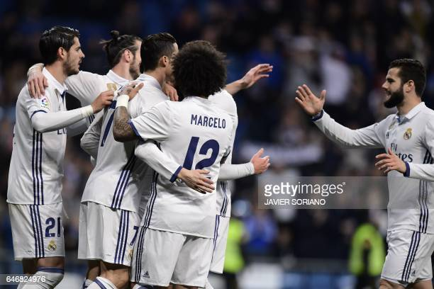 TOPSHOT Real Madrid players celebrate after scoring during the Spanish league football match Real Madrid CF vs UD Las Palmas at the Santiago Bernabeu...