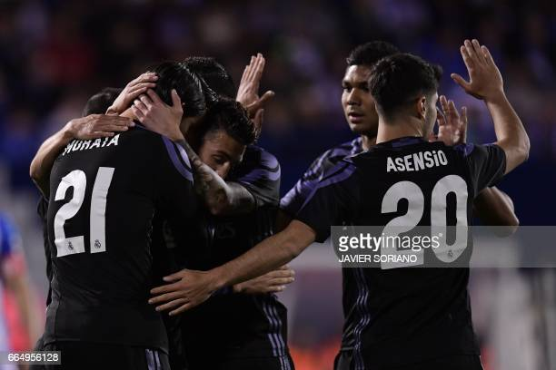 Real Madrid players celebrate after scoring their third goal during the Spanish league football match Club Deportivo Leganes SAD vs Real Madrid CF at...