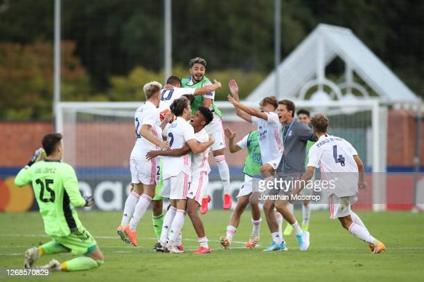 Real Madrid players celebrate after the final whistle of the match during the UEFA Youth League Final 2019/20 between SL Benfica and Real Madrid CF...